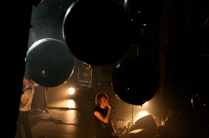 "Giant black balloons filled the venue during the atmospheric ""Circuits of Fever""."