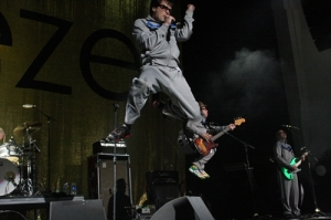 Rivers Cuomo high in the air.